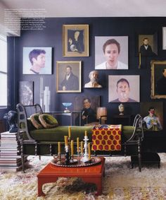 so much to love in this room . green daybed . gallery wall . gold accents . orange accents . stacked books . dark walls . #thingsmatter