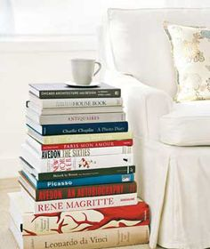 Books as Side Table - Stack several of your favorite (but infrequently read) volumes next to a sofa or chair for an easy side table.