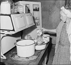 Mrs. Bill Daniels, wife of a miner, canning pears. Panther Red Ash Coal Corporation, Douglas Mine, Panther, McDowell County, West Virginia., 08/26/1946