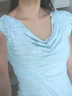 ~~Make this from a over large t-shirt -- DIY tutorial ~~ done properly with a higher neckline to prevent lean forward gaping, this could be a lovely and modest blouse.
