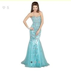 Aqua Jovani Dress in Mermaid Style with Tail This Jovani Style 3008 is a Breath Taking Mermaid that showcases a Unique Strapless Neckline, a Fitted Bodice, and a Fit and Flare Shape. Embellished Sequins and Stones Shimmer Unbelievably giving that Must Have Statement. Fitted Bodice Slims the Silhouette. Feel like your walking the Red Carpet with this Show Stopper. Center Back Zipper Closure. Style 3008 Accessorize with Flashy Tear Drop Earrings, a Chunky Bracelet, and a Small Clutch to keep…