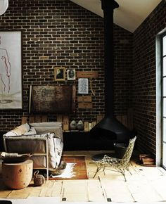 okay, i would paint that brick gray but i LOVE the fireplace and the vintage leather couch... yummy