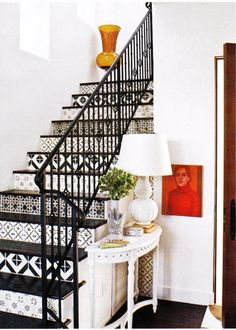Suzie: Love the painted stairs   white black red white orange entrance foyer!