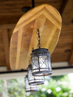 """One-of-a-Kind Light  The """"California cool"""" theme also appears in a retro-style surfboard that serves as a custom light fixture in the game pavilion.  Learn how to light your outdoor rooms like a pro."""