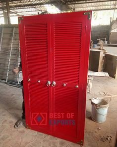 Red Colored shutter design door panel with brass hardware.  #shutter #design #reddoor #woodendoor #doordecor #doordesign #shutterdoor #reddoor #woodendoors #doordesign #brasshardware #walldecor #bestofexports #interiordesigner #Interior_Design #Interior #interiorismo