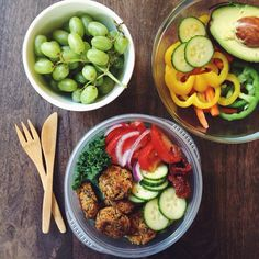 lunch & snacks — baked falafel, kale, fresh + sundried tomatoes, red onion, and cucumber with grapes and veggies on the side