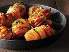 Bacon Hasselback Potatoes. I don't know what a hasselback potato is, but it looks great! YUM