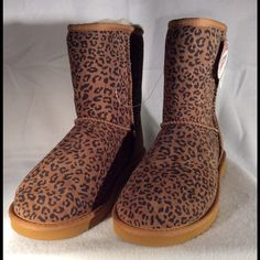 Animal print booties. Brand new never worn. Brand new never used animal print boots. 100% real Australian sheepskin Grade-A. Protected with Scotchgard a Water and Stain repellent from 3M. Extremely high quality booties at an unbeatable price compared to UGG and Bear Paw. Very soft and comfy foam sole inserts. Price is FIRM. COZIE STEPS Shoes Ankle Boots & Booties