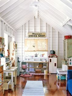Attic Office~love this studio! Check out the dresser in the left corner (only the top & knobs are painted...hmmm).