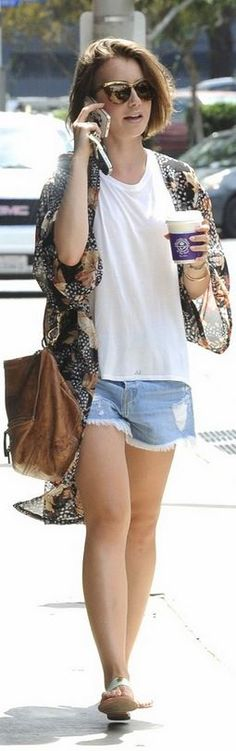Who made Lily Collins' brown leather handbag and print jacket that she wore in Los Angeles on August 25, 2014