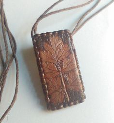 Items similar to Brown Leaf Impression Pendant Handmade Polymer Clay Pendant Costume Jewelry Rectangle Woodland Themed Pendant Modern Jewelry Wearable Art on Etsy Clay Ideas, Pendants, Trending Outfits, Brown, Unique Jewelry, Handmade Gifts, Bags, Etsy, Vintage