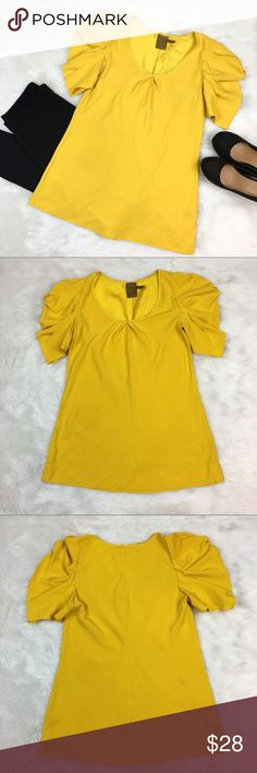 Ali Ro Mustard Silk Top Ali Ro mustard color 100% silk top with semi puffy sleeves. Size 6. Approximate measurements are 27' long and 36' bust. Has two spots on back as pictured. Front has a few fabric pulls. They can barely be seen and I was unable to pick up on camera. ❌No trades ❌ Modeling ❌No PayPal or off Posh transactions ❤️ I 💕Bundles ❤️Reasonable Offers PLEASE ❤️ Bundle & SAVE❗️❗️ Ali Ro Tops Blouses