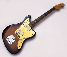 2010~2011 Fender Japan '66 Reissue 3-tone faded sunburst Limited Edition ALG Jazzmaster. Alder Body and Maple neck with rosewood board and anodised aluminium scratchplate. Cool! Rare!