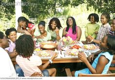 African family eating together outdoors [GOGOBAA02020] > Stock ...