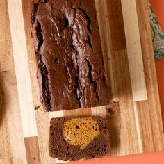 Looking for a quick and easy pumpkin dessert? This chocolate quick bread recipe has a surprise once you cut it. Slice this fall flavored quick bread and you'll reveal the pumpkin-shaped (and pumpkin-flavored) filling hiding inside! #falldesserts #pumpkinrecipes #quickbread #cutedessertideas #bhg Pumpkin Loaf, Cheese Pumpkin, Pumpkin Dessert, Fall Dessert Recipes, Fall Desserts, Fall Recipes, Quick Bread Recipes, Pumpkin Recipes, Chocolate