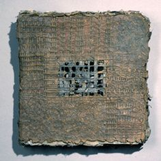 Artist made paper, flax, indigo, black walnut dye, stitched. By Claudia Lee.