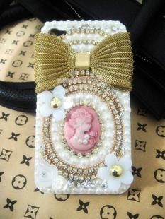 Pink Cameo & Bow Bling Case Kit; Includes Glue Tools & Phone Case. $12.95, via Etsy.