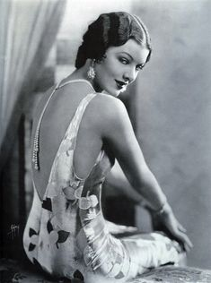 Myrna Loy, 1920s actress. Love her necklace and low back dress.