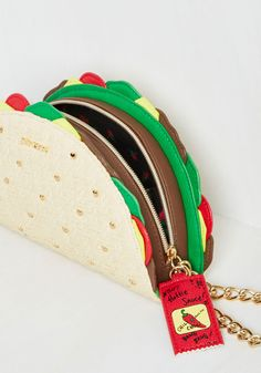 Taco the Town Clutch. Stepping out in this clutch by Betsey Johnson, you quickly see that everyone wants a piece of its flavorful flair! #tan #modcloth
