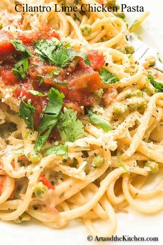 Epic flavor combination in this pasta chicken recipe. Cilantro lime chicken in a creamy Alfredo sauce tossed together with some vegetables and fettuccine pasta. A delicious dinner that is quick and simple to prepare. Zesty lime and cilantro pairs perfectly with the creamy Alfredo sauce. #chicken #limecilantrochicken #chickenpasta #easychicken #dinner
