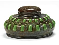 Tiffany Studios | INKSTAND impressed TIFFANY STUDIOS/NEW YORK/7718 favrile glass and patinated bronze, with the original interior clear glass inkwell and plastic insert 3 7/8  in. (9.8 cm) high  6 1/2  in. (16.5 cm) diameter circa 1905 | Sotheby's