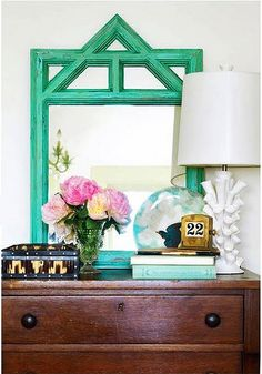 Love this for an entryway. I am loving all the shades of teal with the crisp white lamp.