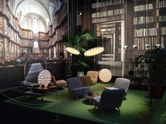 At Salone ,Moooi showcased its newest products set against large scale prints by Massimo Listri