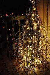 Decorate your home from the inside out.  A Stick Tree is rustic and pretty.  Plus it will show your Christmas spirit to all your neighbors.  It doesn't get much prettier than this.