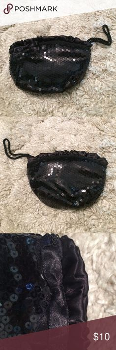 Sequin wristlet Black sequin wristlet with a bow. No flaws. Bags Clutches & Wristlets