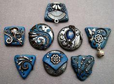 Silver and Denim Blue pendants, via Flickr.  Mandarin Moon/ Chris Kapono