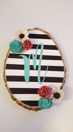 Wood slice with initial on stripes and floral