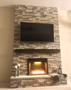 We even made the concrete hearthstone ourselves (built the casing and bought a molding for the cut look on the edges! Airstone Wall, Airstone Backsplash, Airstone Fireplace, Build A Fireplace, Fireplace Mantle, Fireplace Ideas, Fireplaces, Living Room Redo, Living Room Remodel
