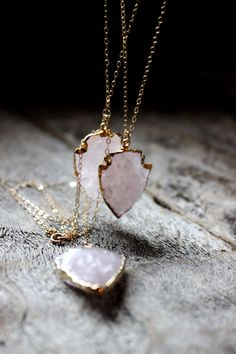 Rose Quart Arrowhead Edged in 24K Gold by WildPeopleFreeSpirit. All her jewelry is out of control cool