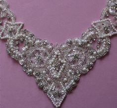 THIS LISTING: Viola measures 21cms (8.3) across and 16cms (7) deep and is sure to add a certain glamour to any dress. Our designer has used a variety of pearls, diamantes and beading to create a very beautiful adornment for the neckline of any dress, whether it be bridal, prom or evening wear. We are the go to source for designers and dressmakers alike looking to add a unique touch to their stunning creations. With bridal fashion always changing, it can be a challenge creating a look that…