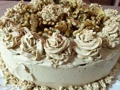 My home-made coffee cake. Enjoyed decorating this cake with coffee flavoured frosting and walnuts.