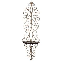 Iron and wood wall shelf in white and brown with a scrollwork motif.  Product: Wall shelfConstruction Material: Metal...