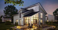 Massivhaus Kern-Haus Familienhaus Akzent Gartenseite am Abend