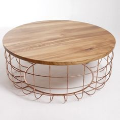 Love love love this coffee table. Wood top, copper wire base