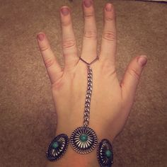 Free People Hand Piece Free People hand piece with conchos and faux turquoise. Chain wraps up to a chain loop that goes around your middle finger. Adjustable clasp on bracelet. Free People Jewelry Bracelets