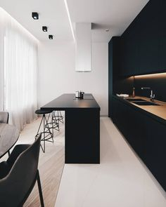 This is my favorite room that shows contrast. I love the dark cabinets with the white tile. It's a very modern look.