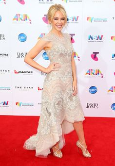 Kylie Minogue in a silver and blush beaded J'Aton Couture dress