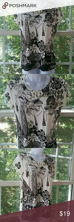 🆕Chico's Travelers Adorable Tropical Print Blouse Chico's Travelers Brand - Cream Colored top with brown print...Cap sleeve...95% Acetate 5% Spandex - Machine Wash Cold - Wash Separately...Tumble Dry Low Chico's Top Size 0= S. Thank you for looking! Xoxoxo Chico's Tops Blouses