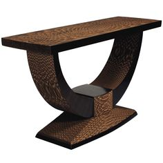 Console Table by Brian Gladwell  USA  2009  Beautifully executed sideboard made from laminated corrugated cardboard. An interesting and thought provoking re-use of this material, designed to be both functional and sculptural. One of a kind object.