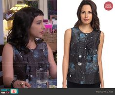 Mandy's galaxy print ruffled top on Last Man Standing.  Outfit Details: http://wornontv.net/48088/ #LastManStanding