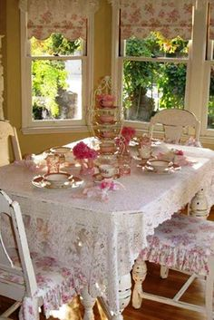 Lovely shabby chic dining room - red and white toile chair covers and valances or roman shades - so sweet!