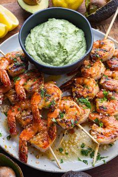 Cajun Butter Garlic Grilled Shrimp with Cilantro Lime Avocado Sauce Cajun Butter Garlic Grilled Shrimp with Cilantro Lime Avocado Sauce - Grilled cajun seasoned butter garlic shrimp on a stick with cilantro lime avocado dipping sauce! Grilled Shrimp Recipes, Seafood Recipes, Shrimp Appetizers, Sauce Recipes, Grilled Garlic Shrimp, Grilled Shrimp Seasoning, Dinner Recipes, Appetizer Recipes, Grilling Recipes