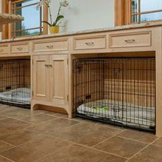 Crown Point Cabinetry. Pet cages under the counter, nice! Would be great in the utility room