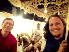 Tim, his Dad and brother on carousel in Colorado