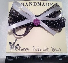 Black and white polka dot hair bow, with pink flower button. #bunnyrootsbows  find us on eBay