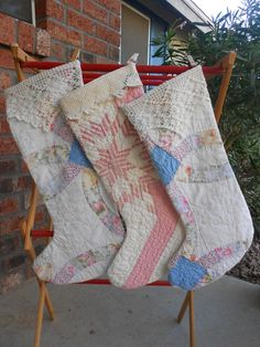Stockings from (damaged) vintage quilts.  You can always salvage a large enough portion to still enjoy the craftsmanship and beauty of an old quilt that has seen a little too much wear!